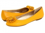 Yellow flats with flower embellishment at 6pm