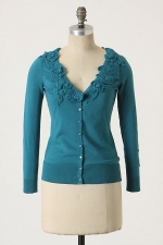 Teal cardigan with crochet flowers at Anthropologie