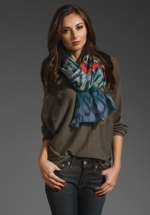 Blue patterned scarf at Revolve