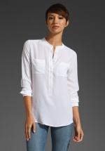 White long sleeve blouse at Revolve