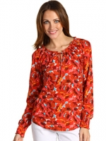 Penny's red top from Big Bang Theory at Zappos
