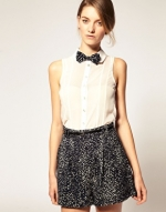 Cream sleeveless top with bow tie at Asos