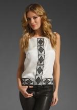 Zoe's diamond print shirt from HoD at Revolve