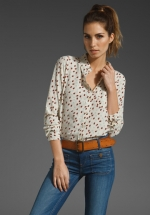 Lemon's tulip print blouse at Revolve
