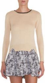 Robin's cream sweater top at Barneys