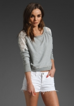 Grey sweater with lace details at Revolve