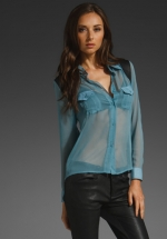 Hanna's sheer blue top with leather detail at Revolve