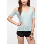 Blue shirt with shoulder cutouts at Urban Outfitters