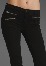 Black jeans with zip pockets at Revolve