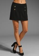 Rachel's pleated skirt at Revolve