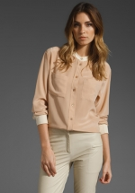 Cream and white colorblock blouse at Revolve