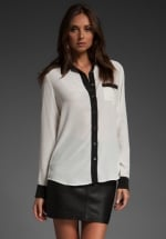 Black and white blouse at Revolve