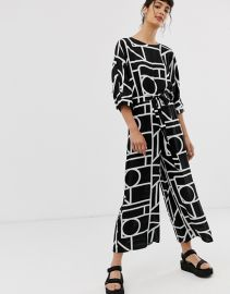 ASOS DESIGN Tie Waist Jumpsuit in mono geo print at Asos
