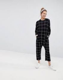 ASOS DESIGN minimal jersey jumpsuit with batwing sleeve in check print at ASOS