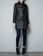 Alex's long black quilted coat at Zara