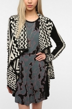 Aria's black and white cardigan from Urban Outfitters at Urban Outfitters