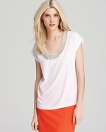 Ashley's white beaded top by DvF at Bloomingdales