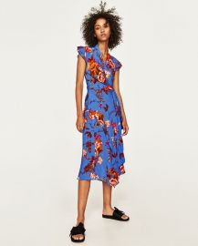 Asymmetric length dress at Zara
