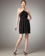 Black halter dress with ruffles at Last Call