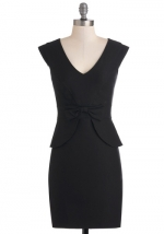 Black peplum dress with bow front at Modcloth