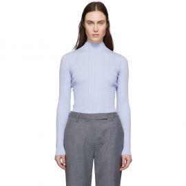Blue Ribbed Turtleneck Sweater at Ssense