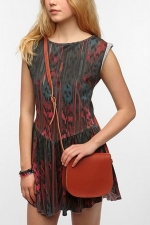Brown saddle flap bag at Urban Outfitters at Urban Outfitters