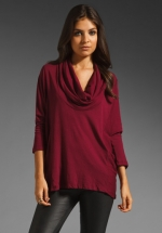 Burgundy cowl neck top at Revolve