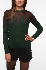 Carrie's green glitter sweater at Urban Outfitters