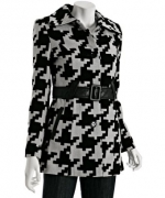Carries houndstooth coat by Via Spiga at Bluefly