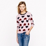 Carries pink heart sweater at Jcrew at J. Crew