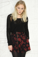 Clara's red and black floral skirt at Urban Outfitters