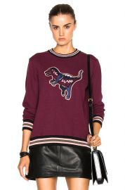 Coach Varsity T Rex Sweater at Forward