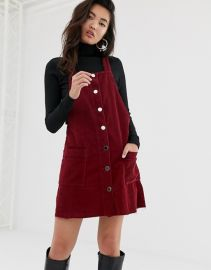 Cord Pinny Dress inBburgundy by River Island at Asos