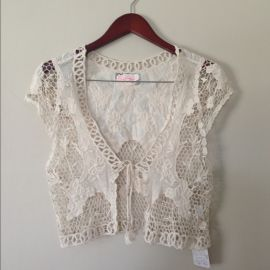 Crochet vest by Free People at Poshmark