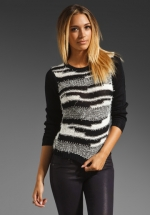 Dorrit's black and white Alice and Olivia sweater at Revolve