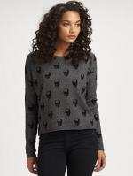 Dorrit's grey sweater at Saks Fifth Avenue