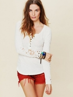 Emily's white thermal tee with crochet sleeves at Free People