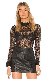 Endless Rose Ruffle Mock Neck Blouse in Black from Revolve com at Revolve