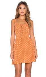 FLYNN SKYE Leila Lace Up Mini Dress in Pumpkin Seeds at Revolve