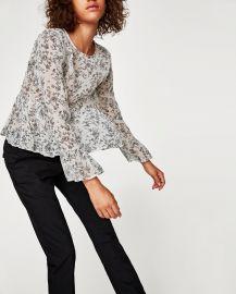 Flowing peplum blouse at Zara