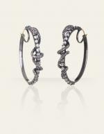 Georginas earrings on the Gossip Girl finale at Danielle Queller