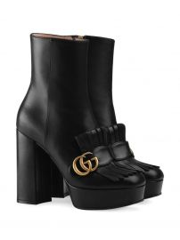 Gucci leather ankle boot with plateau and fringe  leather ankle boot with plateau and fringe at Farfetch