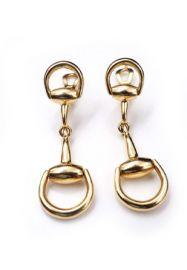Horsebit earrings at Gucci