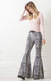 Just Float On Printed Flare Jeans by Free People at South Moon Under