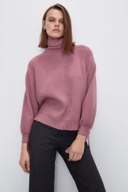 Knit sweater with tied cuffs at Zara