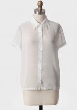 Maggie's white blouse at Ruche
