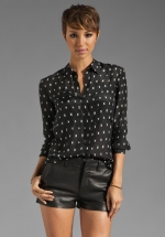 Mindy's black shirt at Revolve