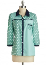 Mindy's mint polka dot shirt at Modcloth