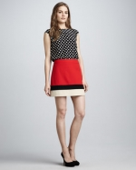 Mindy's red skirt at Neiman Marcus
