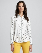 Mindy's white patterned shirt on The Mindy Project at Neiman Marcus